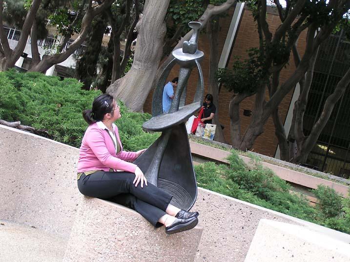 LisaSeatedBySculpture