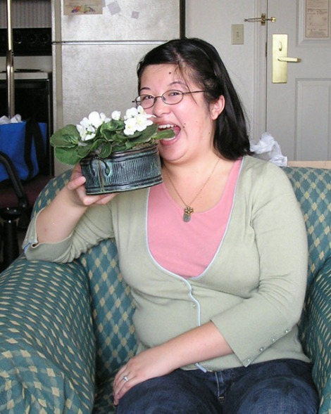 PB250136.Lisa eating flowerpot