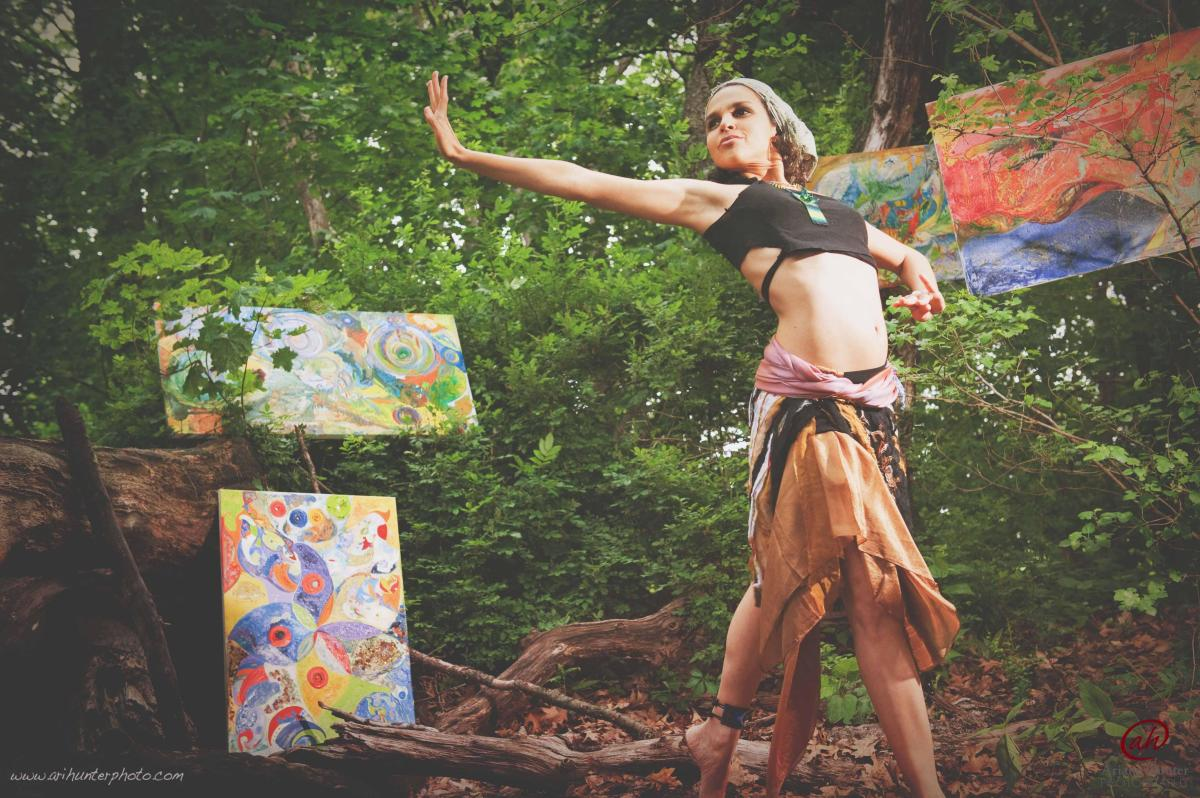 Dancing woman among art