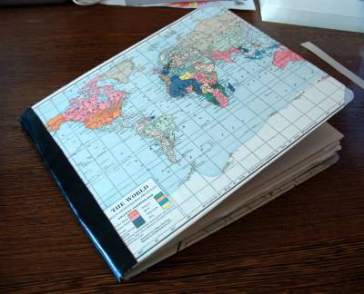 Sketchbook covered in vintage world map