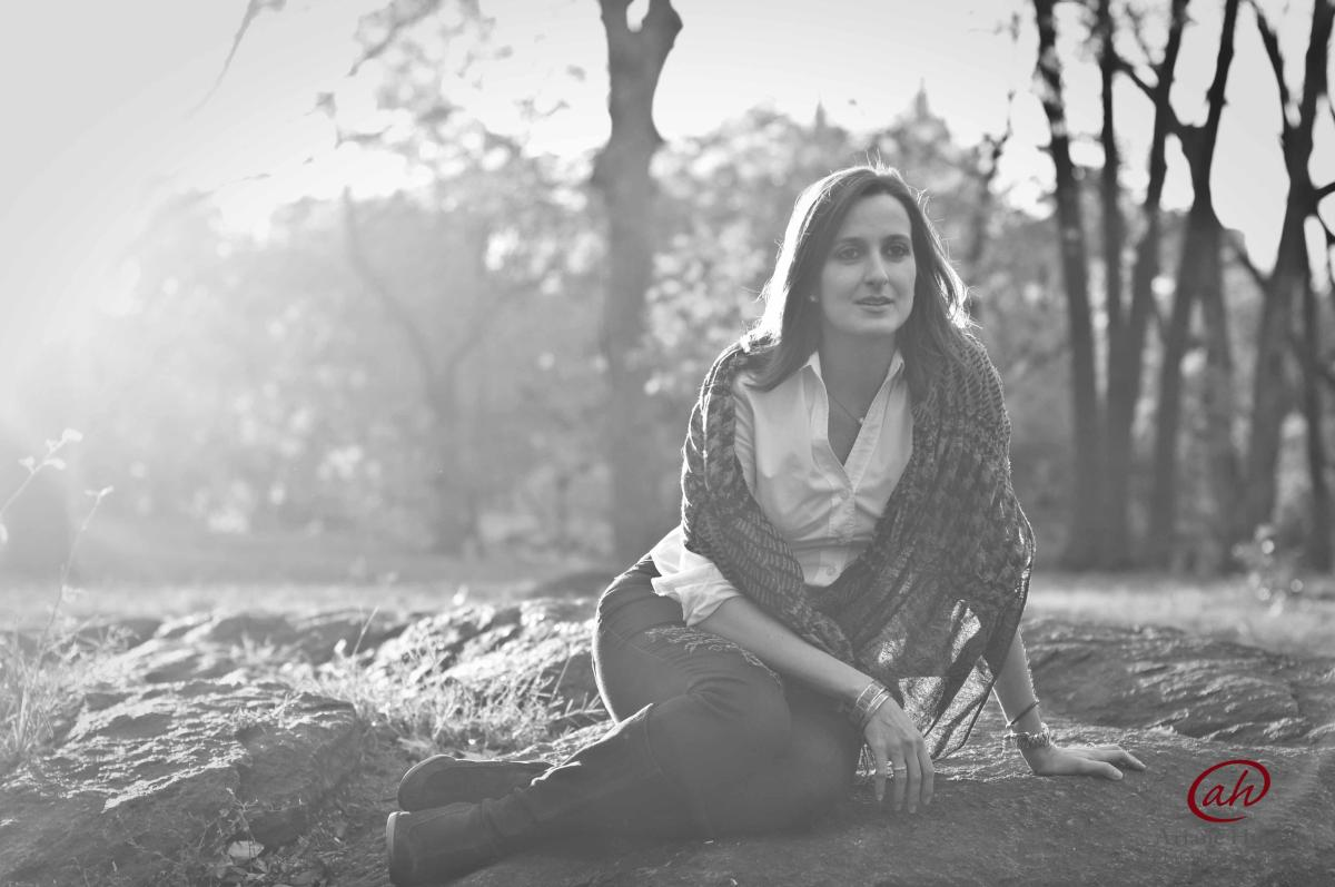 BW photo of a woman sitting on the ground
