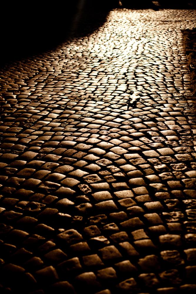 Cobblestone path at night