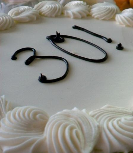 "Cake with ""30!"" written on the white-chocolate buttercream"