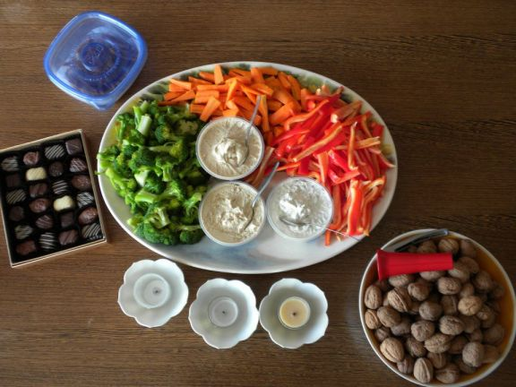Crudités, See's chocolates, walnuts in shell.
