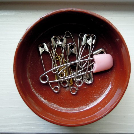 Safety pins in a dish