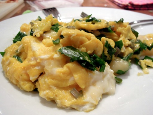 Scrambled eggs with chopped ramps and oka cheese