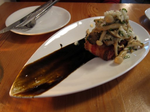 Crispy pork belly topped with mushrooms