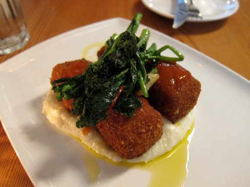 Deep-fried beef tendon over buttery grits, with some spinach (?) on top