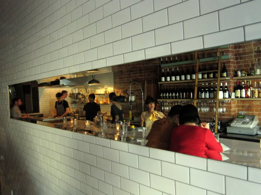 Shot of our backs in the mirror hanging across from the bar