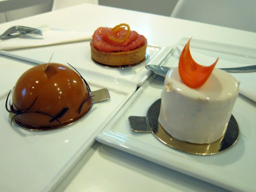Three desserts: salted caramel dome mini-cake, grapefruit tart, carrot cake