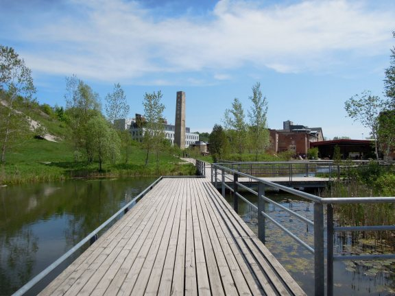 Walkway over the pond, looking back toward the brick works