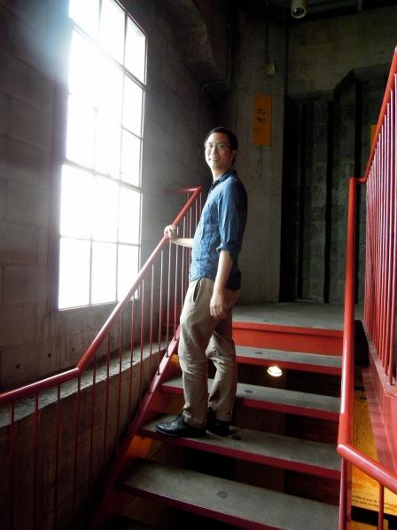 Erik climbing the clock tower stairs