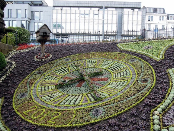 Working clock landscaped with flowers at the West Princes St Gardens