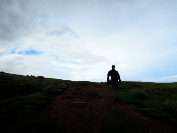 Erik silhouetted against the sky