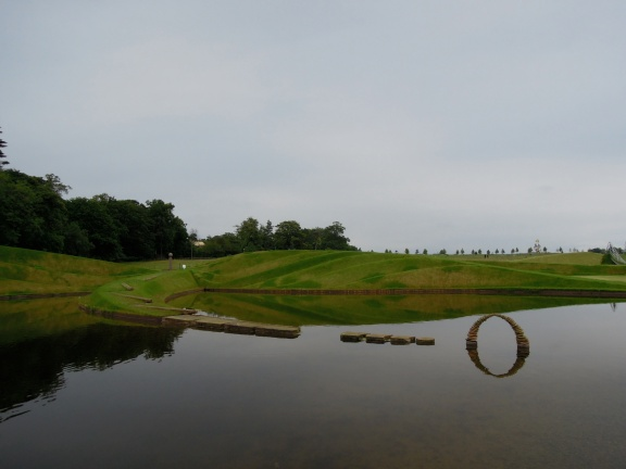 Stone arch reflected in the water of the Life Mounds