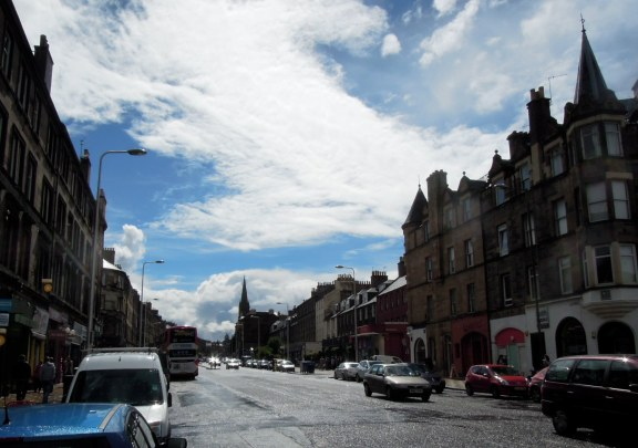View to city from Leith Walk: wet street, sunny sky
