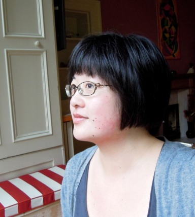 Sitting in the bay window of the Edinburgh flat, after my haircut.
