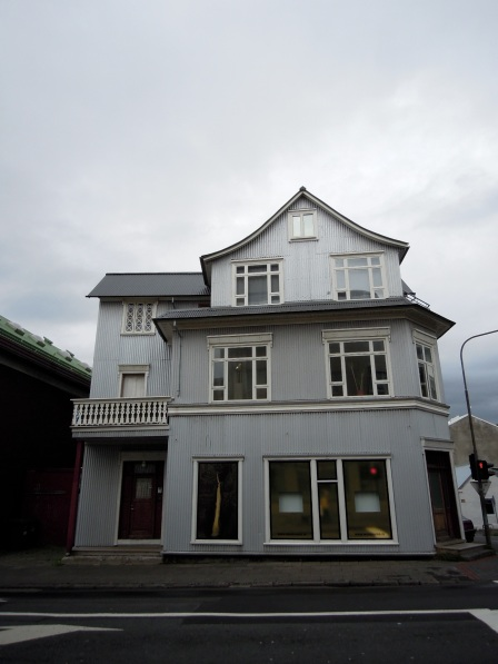 Three-story house in Reykjavík on a cloudy day