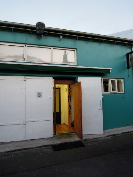 Teal building with open door