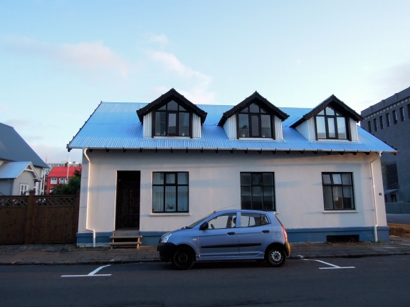 White house with blue roof and black trim