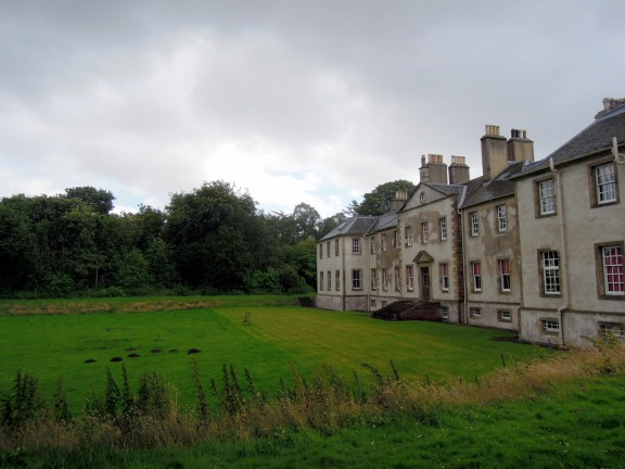 The back side of Newhailes with a lawn and path
