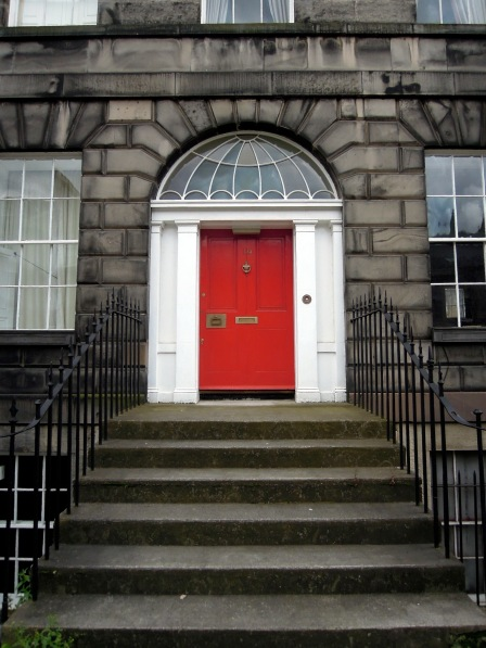 One of Edinburgh's attractive red residential doors.