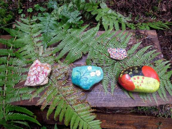Painted rocks on ferns