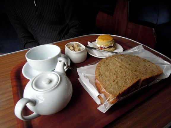 Tea, cream scone, and takeaway sammiches at the Glenfinnan Dining Car
