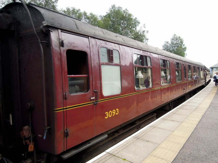The distinctive red cars of the Jacobite Steam Train
