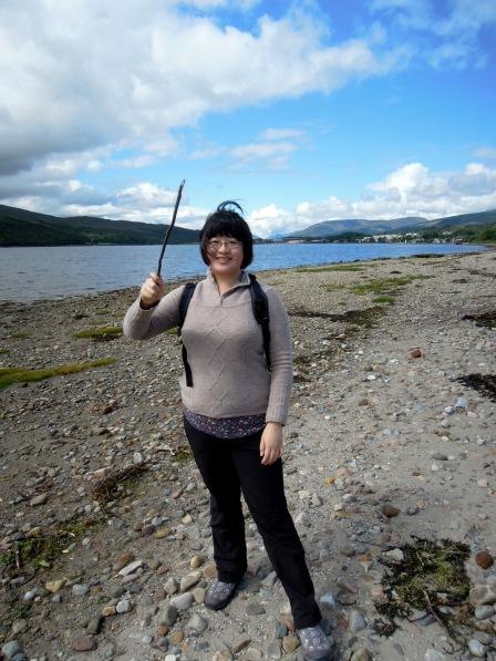 Lisa holding up a wand-like stick