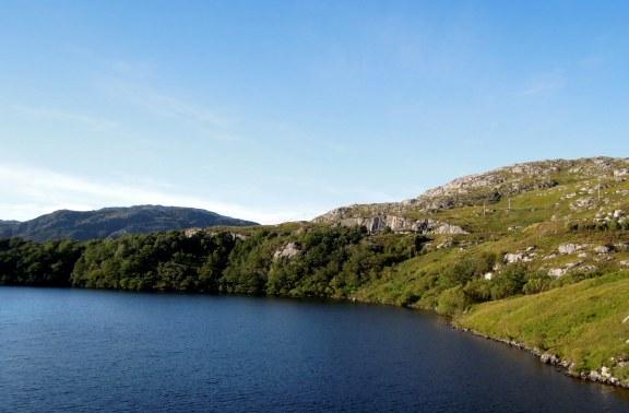 Water (loch?) with green hills around