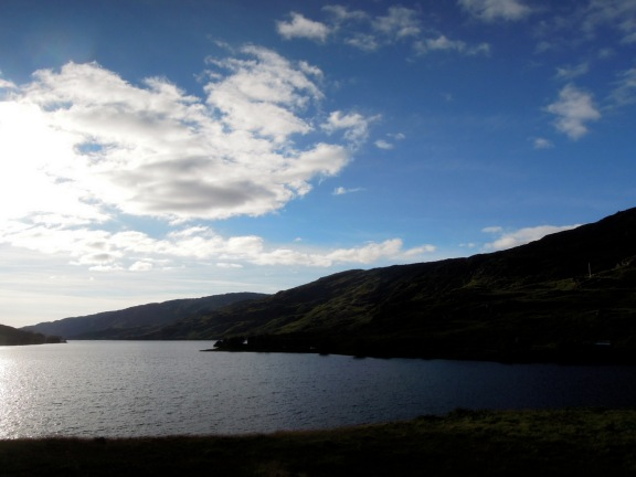 Silhouetted hills and loch