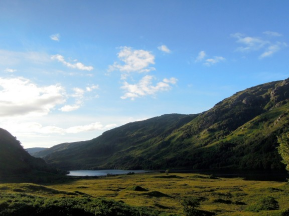 Loch amid green hills