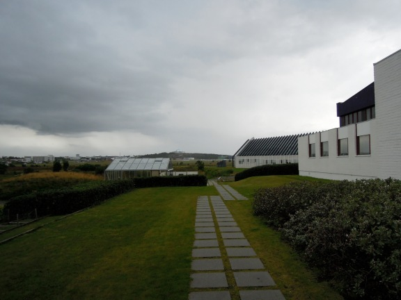 Nordic House greenhouse and path on an overcast day