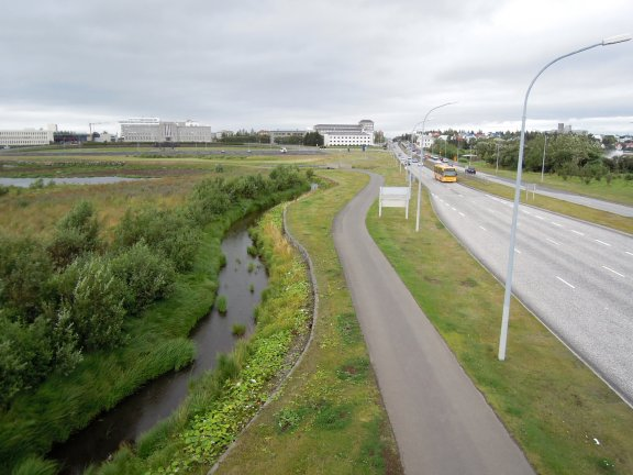 Reykjavík roadside with street, trail, and river