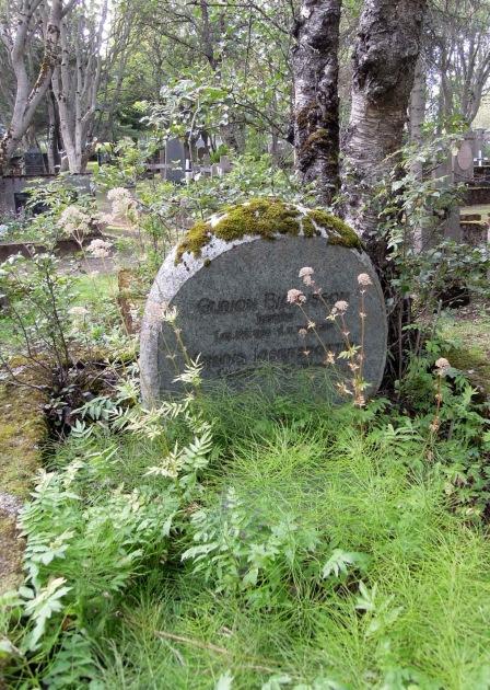 Moss-covered gravestone