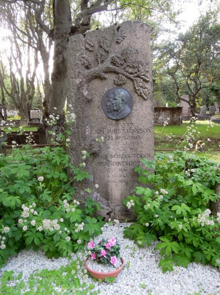Lovely gravestone with carvings and a profile