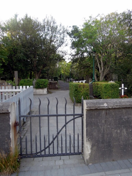 One of the small iron entrance gates to the cemetery
