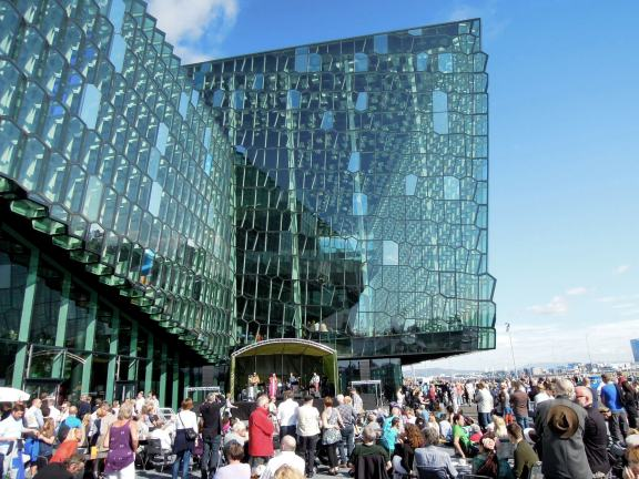 Performers on an outdoor stage outside Harpa concert hall