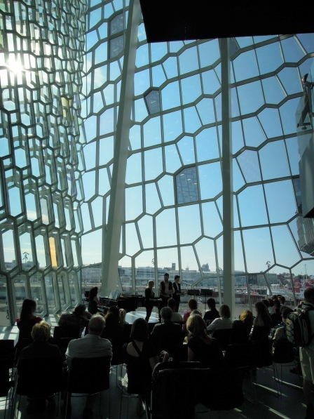Young musicians performing in an atrium in Harpa concert hall