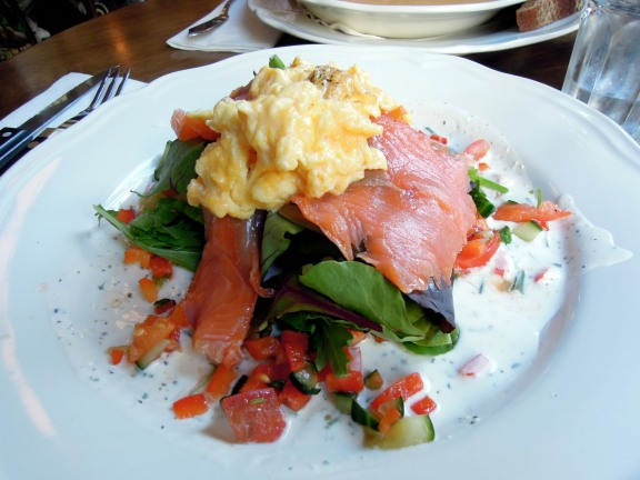 Smoked salmon and scrambled eggs and salad on toast