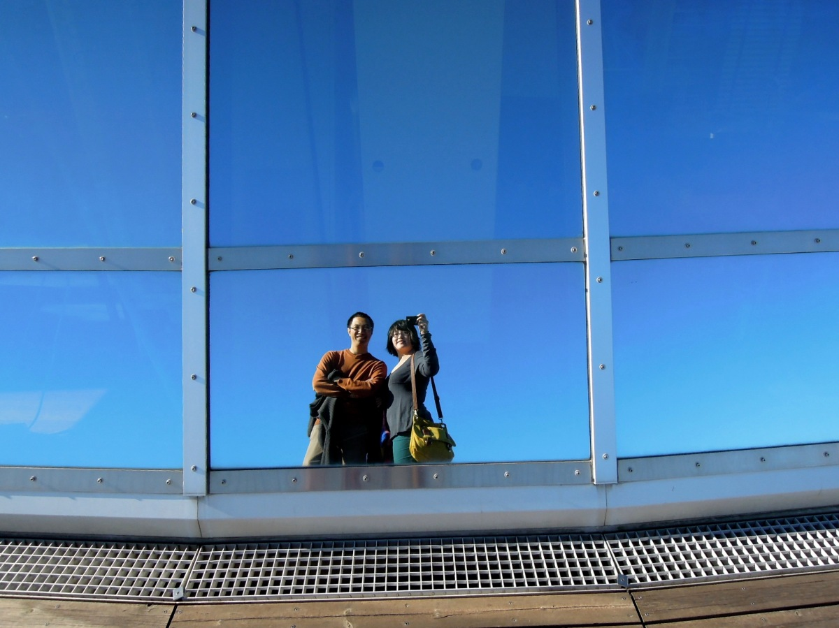 Double portrait in the reflective surface of the dome of Perlan
