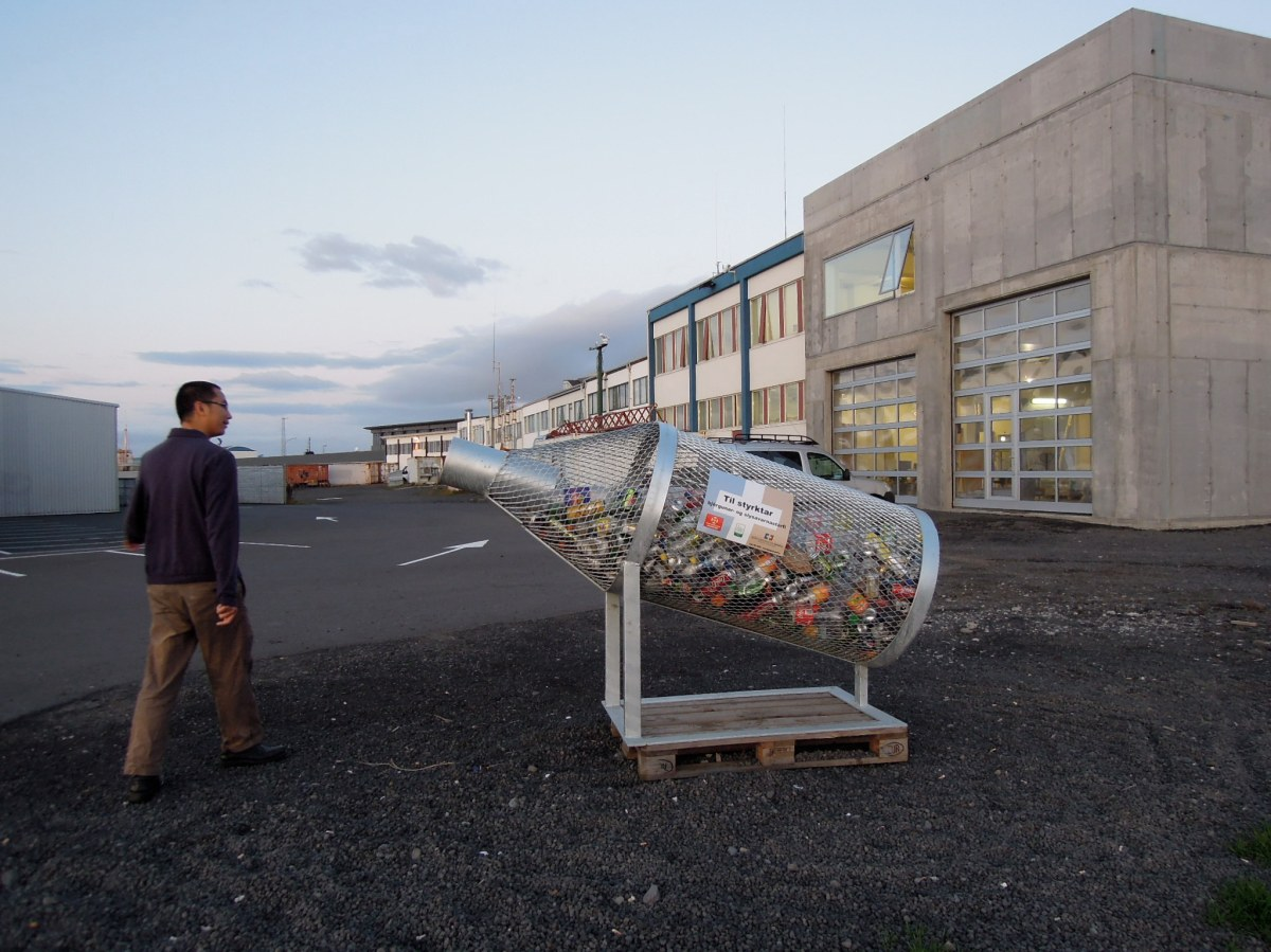 Bottle-shaped recycling bin