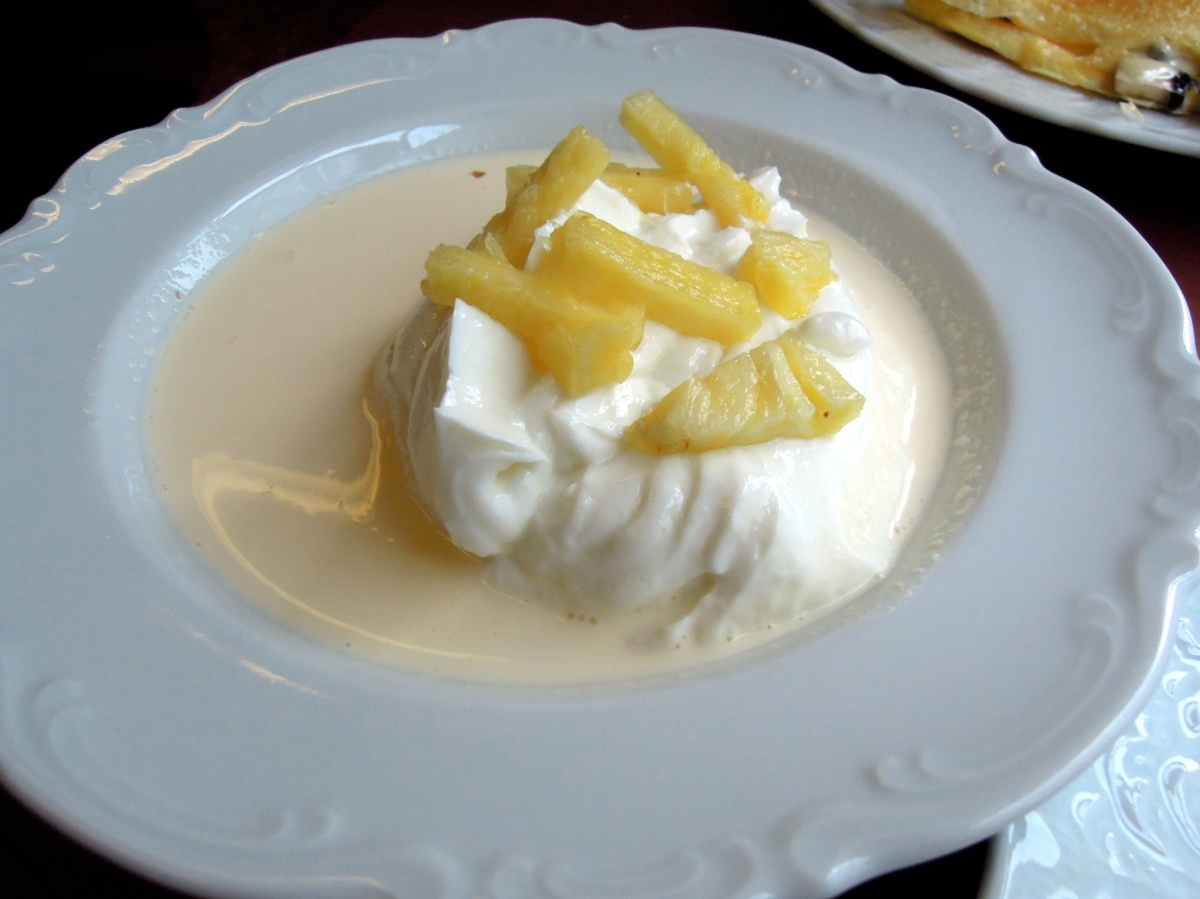 Skyr topped with pineapple and cream.