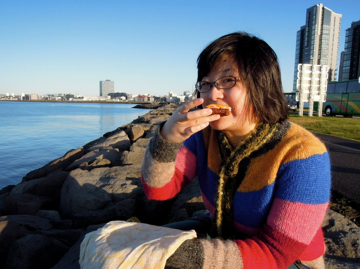 Lisa eating an open-faced sandwich