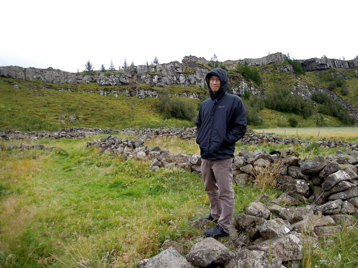 Erik standing on old stone foundations