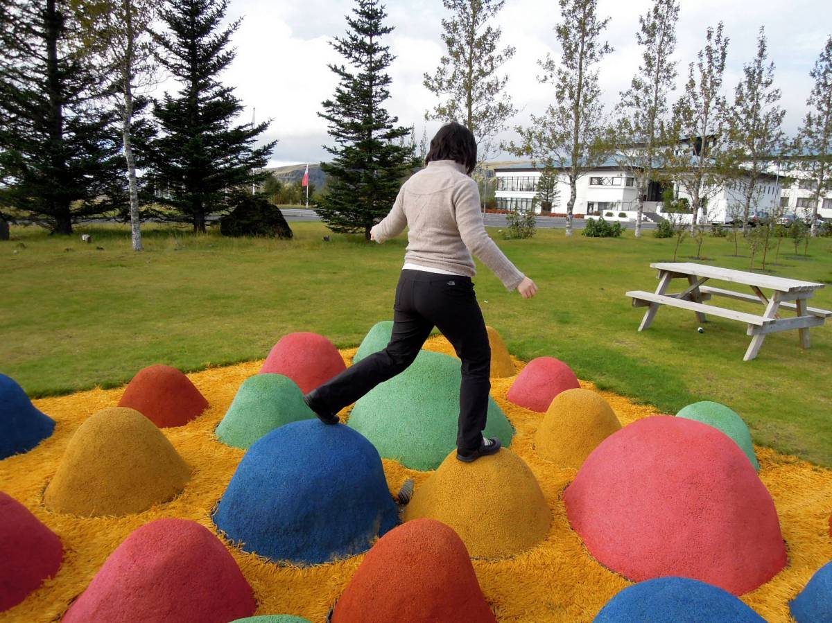 Lisa walking around on the raised colorful mounds