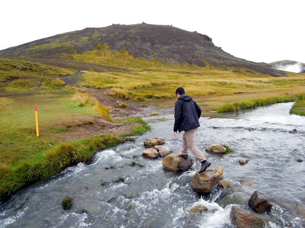 Erik crossing the river on rocks