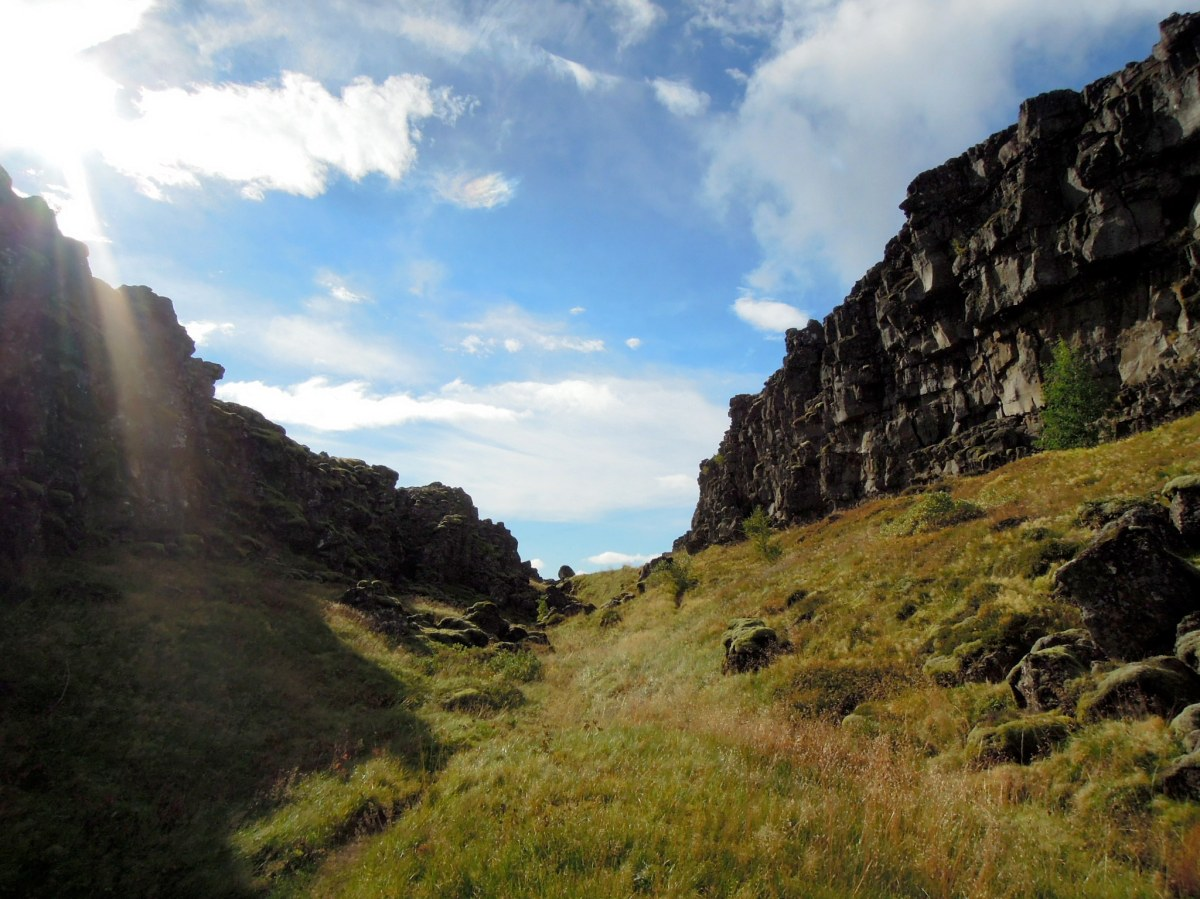 Grassy trail between cliffs