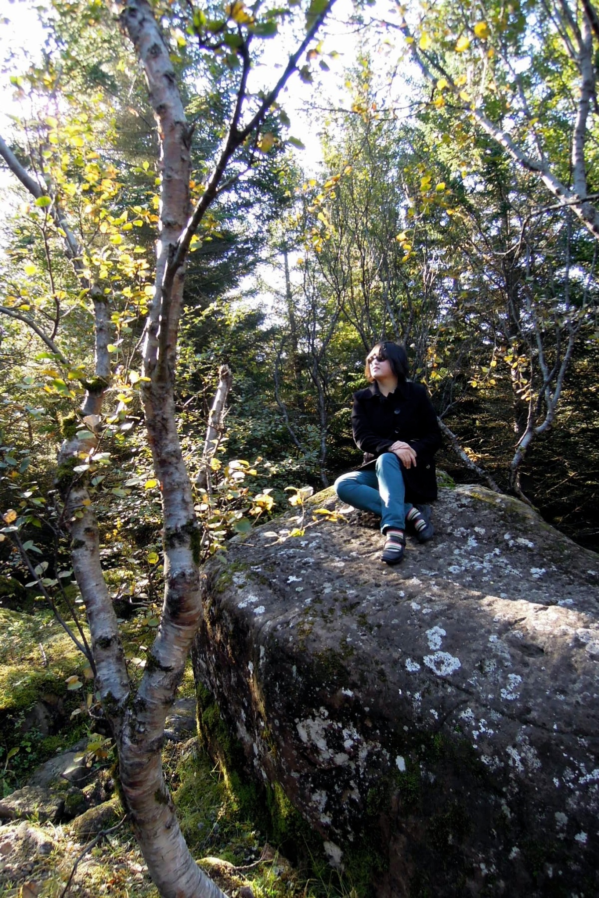 Lisa sitting on a boulder